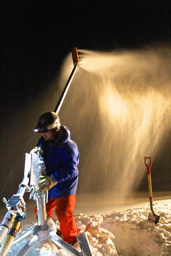 Caleb Dilworth, 25, of Greenbush steadies a snow gun beside a ski trail on Sugarloaf Mountain on Jan. 9 after clearing snow away from the gun's base with other members of the nighttime snowmaking crew.
