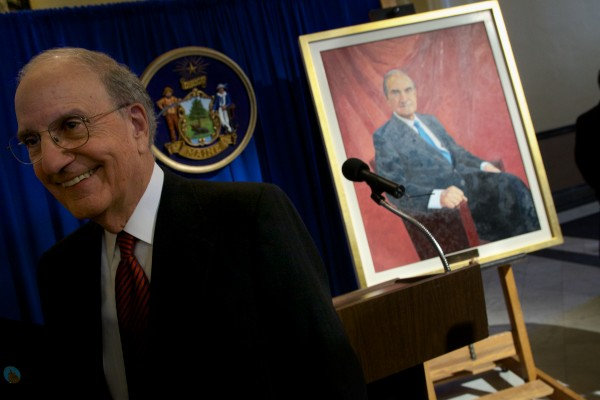 Former U.S. Sen. George J. Mitchell smiles at the unveiling of his official portrait in the State House in Augusta on Tuesday.
