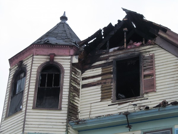 This 84 Irving St. home in Portland, where as many as seven people lived in rented rooms and apartments, was severely damaged by fire Sunday night. All the residents escaped the building, according to one man who lived there, but the landlord's cat has not been found.