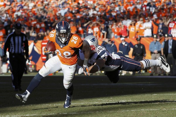 Denver Broncos running back Montee Ball breaks away from New England Patriots Rob Ninkovich during the fourth quarter in the NFL's AFC final Sunday in Denver.