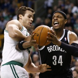 Rondo helps Celtics beat Nets, snap two-game losing streak