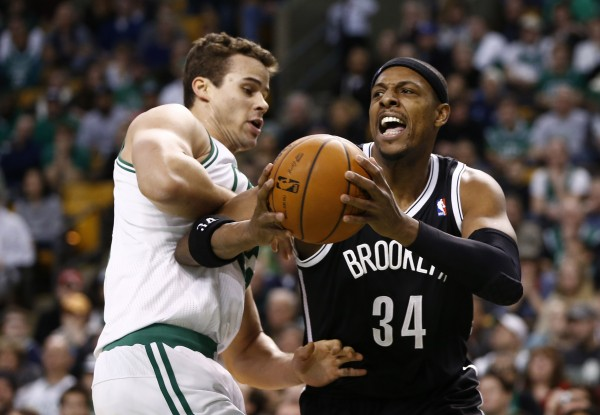 Brooklyn Nets small forward Paul Pierce (34) passes the ball against Boston Celtics center Kris Humphries (left) during the second half at TD Garden in Boston Sunday night.