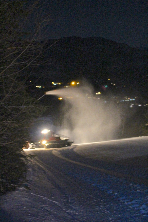 The snowcat used by the Sugarloaf nighttime snowmaking crew sits at a hydrant beside Tote Road, which at 3.5 miles is the longest trail on the mountain, on Jan. 9. Snow shoots from a gun overhead, fired up by the vehicle's driver, Johnny Markham, 35, of Kingfield.