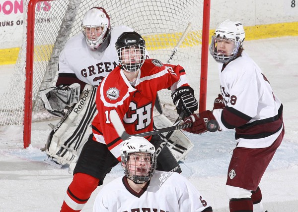 Greely goaltender Kyle Kramlich looks on as teammates Matt Ames (right) and Brian Storey (foreground), along with Grayson Szumilas of Camden Hills (center) watch the puck in in last season's Western Maine Class B final in Lewiston. Szumilas has helped Camden Hills to a 7-0-1 start this season.