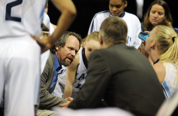 Maine women's basketball head coach Richard Barron talks with his team during a timeout on Sunday at the Cross Insurance Center. Stony Brook won 65-49.