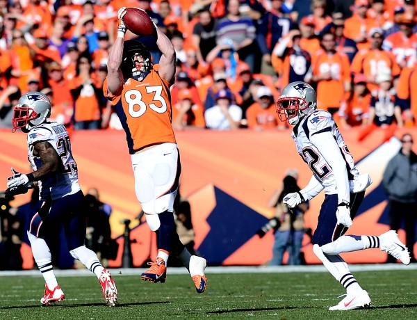 Denver Broncos wide receiver Wes Welker (83) catches a pass against the defense of New England Patriots free safety Devin McCourty (32) in the first half of the AFC final Sunday at Sports Authority Field in Denver.