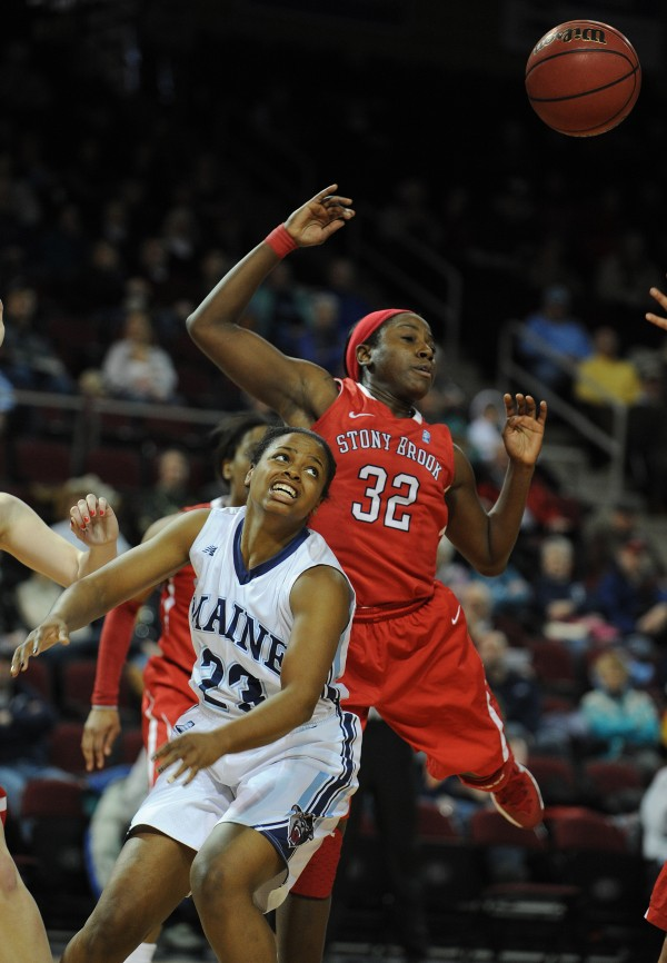 Maine's Ashleigh Roberts has a rebound slapped away from her by Stony Brook's Chikilra Goodman at the Cross Insurance Center on Sunday. Stony Brook won 65-49.