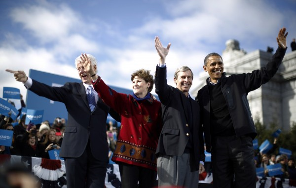 U.S. President Barack Obama gathers on stage with (L-R) former U.S. President Bill Clinton, U.S. Senator Jeanne Shaheen (D-NH) and New Hampshire Governor John Lynch at an election campaign rally in Concord, New Hampshire, November 4, 2012.