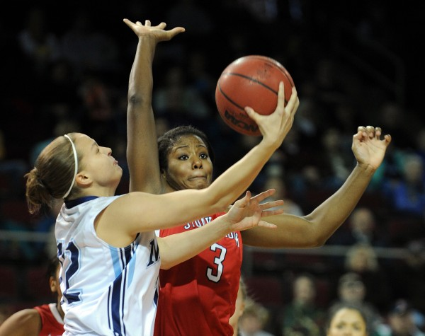 University of Maine's Liz Wood has her shot blocked by Stony Brook's Jessica Ogunnorin at the Cross Insurance Center on Sunday. Stony Brook won 65-49.