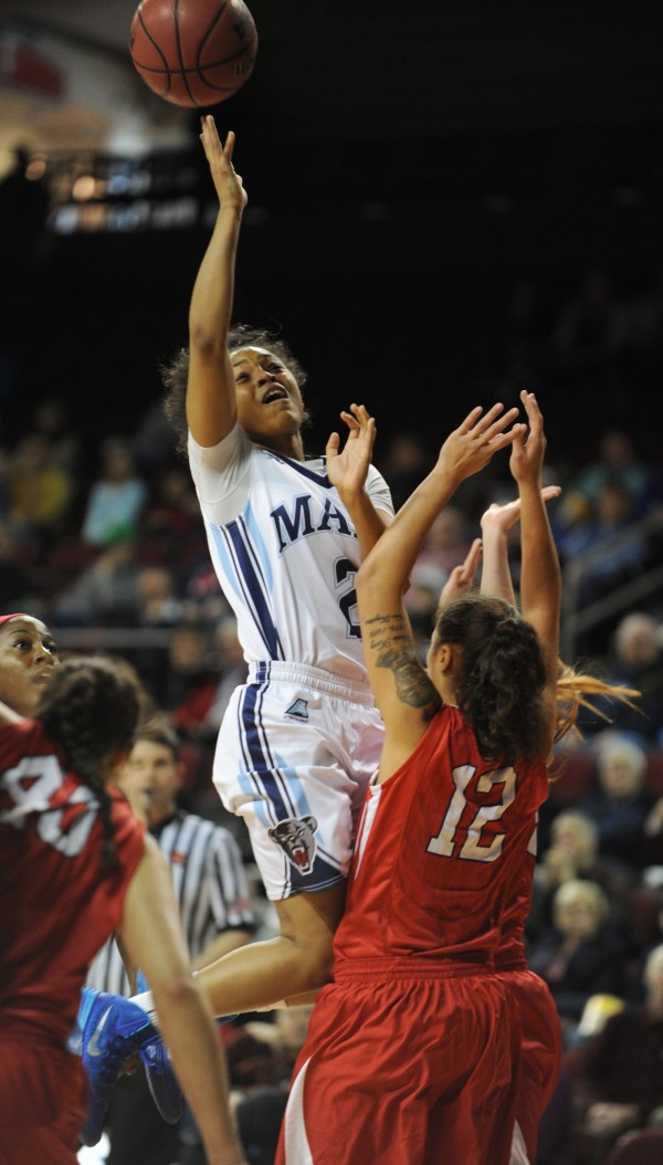 UMaine's Cherrish Wallace shoots over Stony Brook's Teasha Harris at the Cross Insurance Center on Sunday. Stony Brook won 65-49.