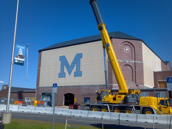 Workers from P.C. Construction of Portland and Cote Crane of Auburn perform work on the the University of Maine field house last year. The facility will open for a high school track meet on Saturday.