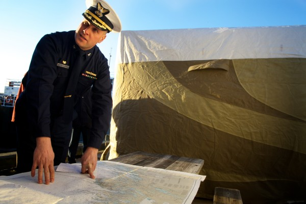 At a South Portland press conference, Capt. Brian S. Gilda shows where the Coast Guard searched for a possibly sinking sail boat today off Pemaquid Point. The search was suspended at 3:20 p.m.