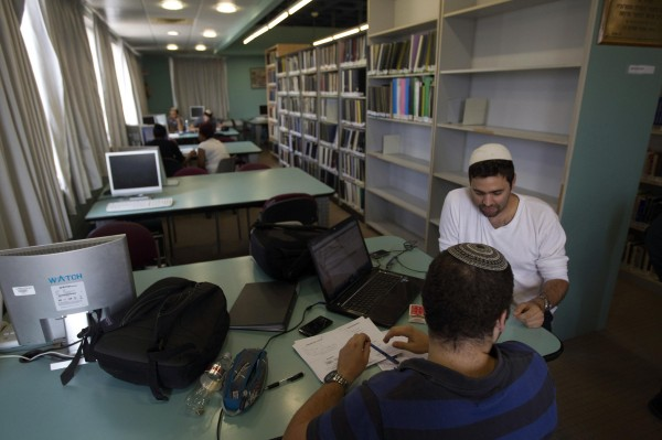Students sit in a library at the Ariel University Centre in the West Bank Jewish settlement of Ariel September 13, 2012.