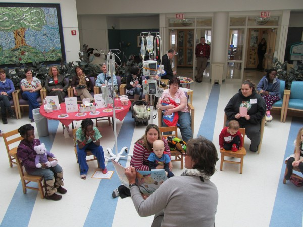 Abigail Snyder, a teacher at Barbara Bush Children's Hospital at Maine Medical Center in Portland, reads a book to a group of children gathered Friday morning for a kick-off event for the organization Raising Readers, which urged parents to resolve in the new year to encourage their children to read.