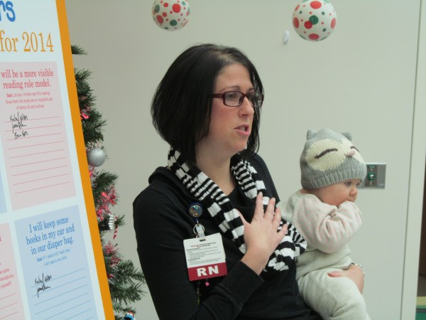 Melanie Janosco, a mother of two and a nurse at Barbara Bush Children's Hospital at Maine Medical Center in Portland, pledges in the new year to read to her children aloud regularly, let her children see her reading to herself often, take her children to the local library frequently and keep books handy in her diaper bag. The hospital and group Raising Readers held a Friday event to announce the four proposed New Year's resolutions for parents.