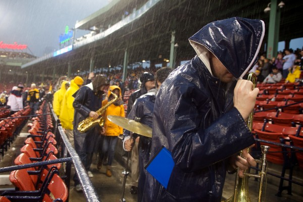 The University of Maine band leaves the stands in a downpour at Fenway Park on Saturday during a hockey game between Maine and Boston University. The game was delayed for an hour.