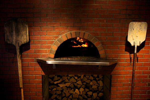 The wood-fired oven at Zapoteca in Portland burns at over 500 degrees.