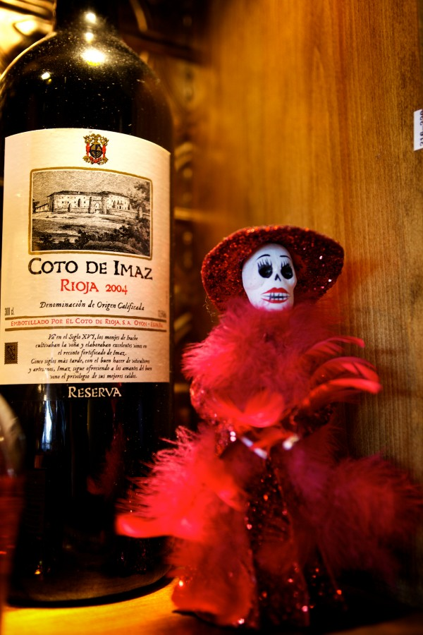 A mexican Day of the Dead doll graces a shelf behind the bar at Zapoteca in Portland.