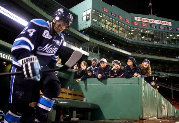 Senior Mark Anthoine of the University of Maine climbs out of the tunnel at Frozen Fenway in Boston Saturday night for the start of the third period against Boston University. The Maine Black Bears went on to win by a score of 7-3.