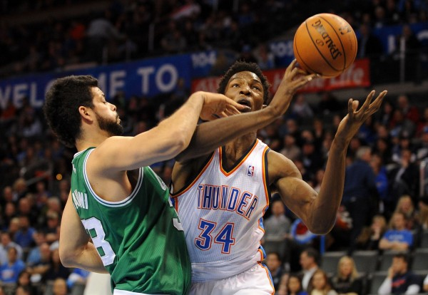 Oklahoma City Thunder center Hasheem Thabeet (34) attempts a shot against Boston Celtics center Vitor Faverani (38) during the fourth quarter at Chesapeake Energy Arena Sunday night in Oklahoma City.