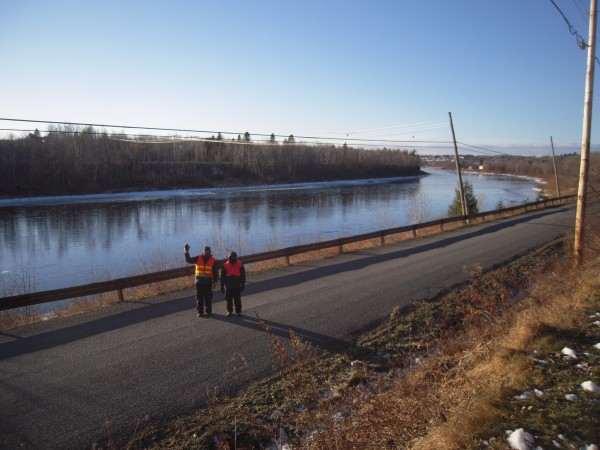 Long-distance hikers Larry Berz and Dr. Narayana Prasana head toward Limestone along the Aroostook River in Caribou on Dec. 8.