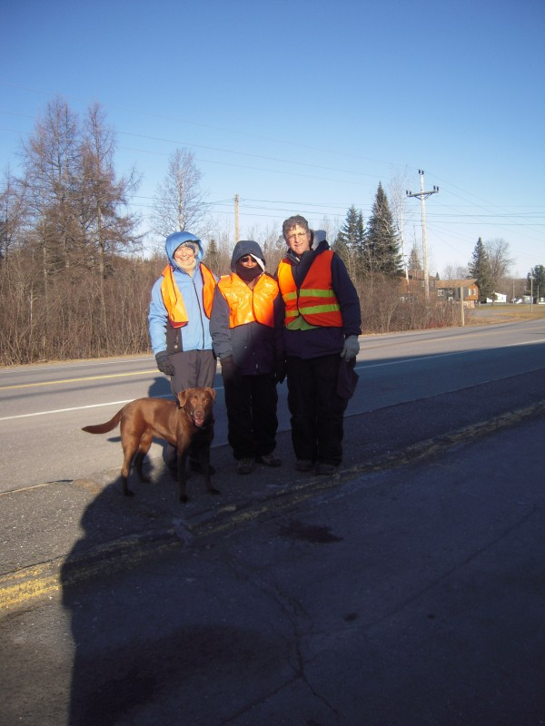 Kathryn Olmstead (from left) and her dog Lucy join Dr. Narayana Prasana and Larry Berz for the first two miles of their walk from Caribou to Limestone on Dec. 8, 2013.