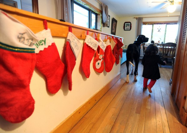 Stockings for 11 family members and two dogs line a wall of Tracey Haskell and Jim Pearsall's Orono home. Their family of seven grew to 11 after the death of Tracey's sister in October.