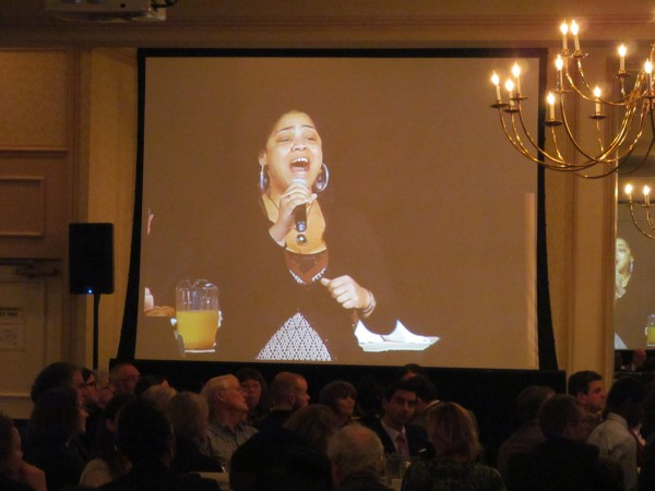 Attendees at the 33rd annual Martin Luther King Jr. Day breakfast in Portland watch on one of four projector screens as singer Kenya Hall sings &quotThere's a Light In My Life Shining Over Me&quot Monday morning. The event took place at Holiday Inn By The Bay and featured keynote speaker William Cohen, former U.S. senator and defense secretary.