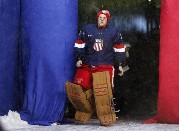 Detroit Red Wings goalie Jimmy Howard is introduced as a member of the U.S. Olympic hockey team after the 2014 Winter Classic hockey game against the Toronto Maple Leafs at Michigan Stadium in Ann Arbor, Mich., Wednesday.