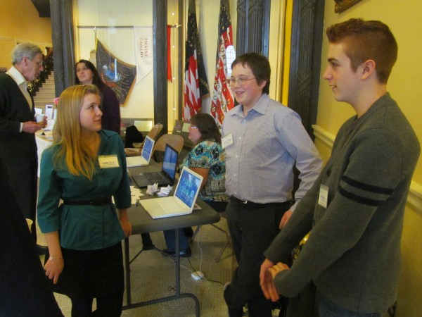 Students from Baxter Academy for Science and Technology in Portland discuss the merits of their charter school on Monday at the State House in Augusta. Pictured from left are Caroline Ross of Gray, Chris Rayner of Scarborough and Riley Deraps of South Portland.