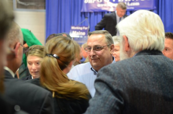 Gov. Paul LePage, center, speaks with supporters at his re-election campaign kickoff event Nov. 5, at the Buker Community Center in Augusta.
