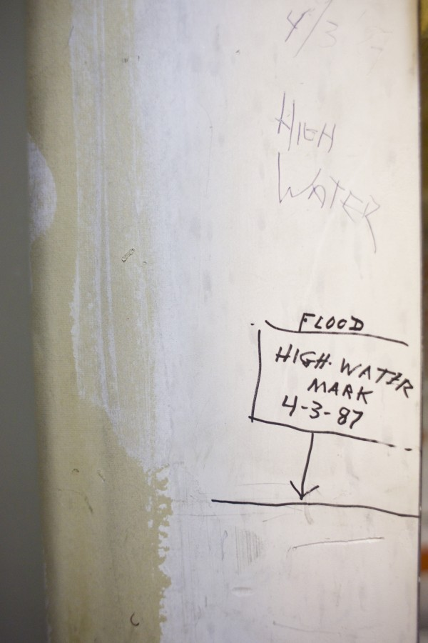 Dale Hustus, the building manager at Merchants Plaza shows high water marks over the years that was recorded on a wall in the buildings first floor. Ice build up on the Penobscot River has brought out the Coast Guard Ice Cutter and potential for flooding in Friday in Bangor.