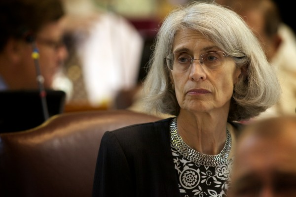 Rep. Peggy Rotundo, House Chair of the Appropriations Committee, listens to more than two hours of debate on June 26, 2013, before the house voted to override the governor's budget veto.