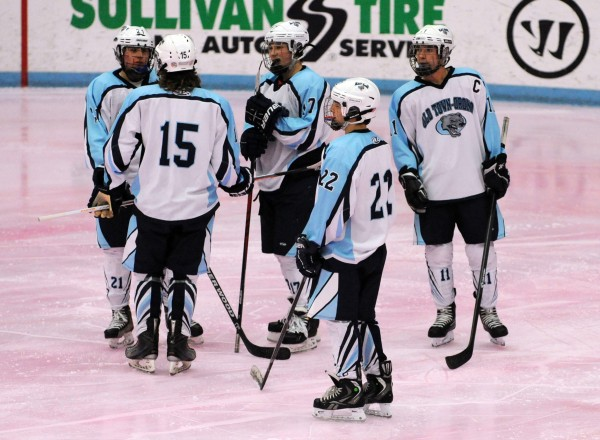 Tyler Byther, Cal Hamilton,Lucas Shorette, Matt Fowler and Nash Allan-Rahill talk while the officials sort out a call during the Old Town/Orono vs. Messalonskee hockey game on Friday night at the Alfond Arena in Orono. Hamilton, Fowler and Nash Allan-Rahill attend Orono High school while the rest of the group attends Old Town High School. The Old Town/Orono varsity team is made up of 16 players from Old Town High School and six players from Orono.