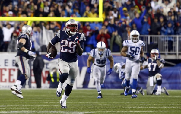 New England Patriots running back LeGarrette Blount (29) runs for a touchdown against the Indianapolis Colts in the second half during the 2013 AFC divisional playoff football game at Gillette Stadium Saturday night.