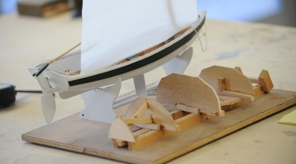 A model of a Shellback dinghy, a small sail boat, sits on a table at the former Hamilton Marine Seine Loft on Main Street in Searsport on Tuesday.