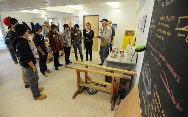 Greg Rossel speaks with students from Searsport District High School about the art of boat building in the new classroom located in the former Hamilton Marine Seine Loft in Searsport on Tuesday.