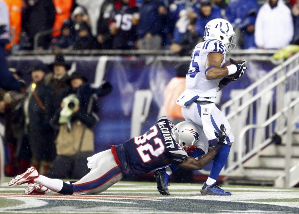 Indianapolis Colts wide receiver LaVon Brazill (15) scores a touchdown past New England Patriots free safety Devin McCourty (32) in the second half during the 2013 AFC divisional playoff football game at Gillette Stadium Saturday night.