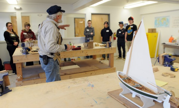 Greg Rossel introduces students from Searsport District High School to the art of boat building in the new classroom located in the former Hamilton Marine Seine Loft in Searsport on Tuesday.