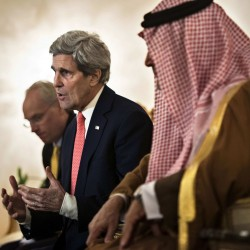 Saudi Minister of Foreign Affairs Prince Saud al-Faisal bin Abdulaziz al-Saud (R) listens as U.S. Secretary of State John Kerry makes a statement to the press at King Khalid International Airport in Riyadh January 5, 2014.