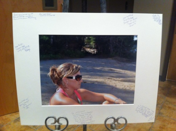 Family and friends on Friday wrote messages to Hilary Saenz on a photo placed in Pathway Vineyard Church in Lewiston.