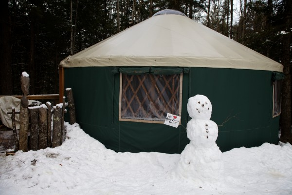 Recent guests erected a snowman outside a yurt at Maine Forest Yurts in Durham. The 100-acre retreat is run by the Crowley family.