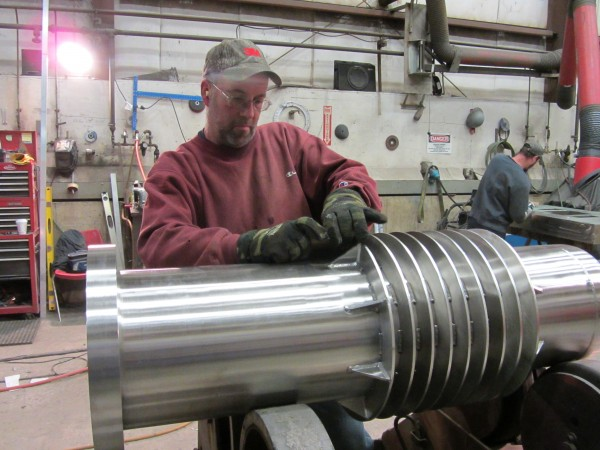 Chris Jarvis polishes a stainless steel filter that is manufactured at SteelPro in Rockland.