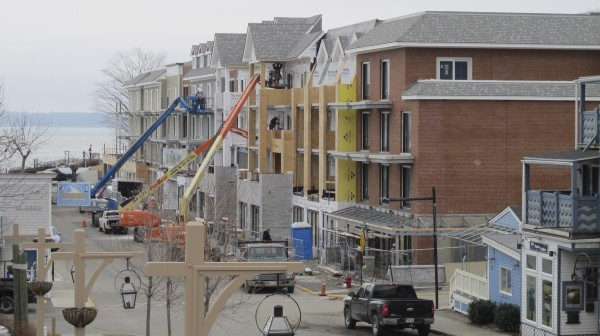 Workmen put up siding in March 2012 on the West Street Hotel in Bar Harbor.