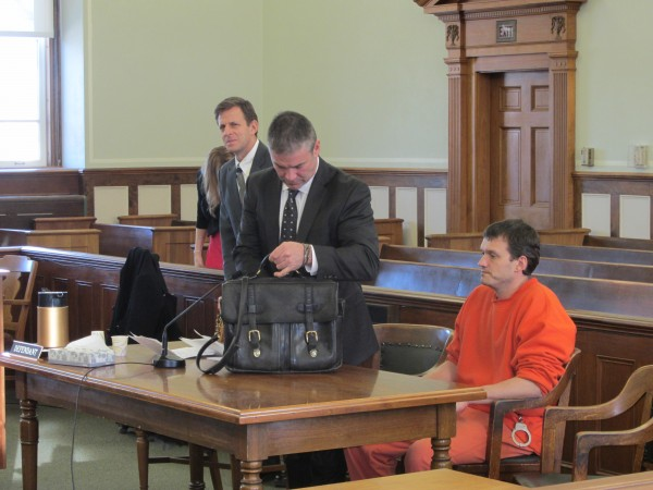 John Thibeault sits at the defendant's table on Jan. 9 in Knox County Superior Court moments before pleading no contest to aggravated assault in connection to the 2009 beating death of fellow prisoner Sheldon Weinstein. Pictured with Thibeault are attorneys Philip Cohen, center, and Jonathan Handelman.