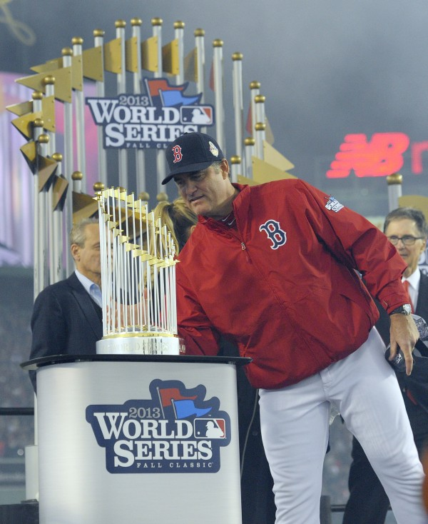 Boston Red Sox manager John Farrell looks at the World Series championship trophy after Game Six of the World Series against the St. Louis Cardinals at Fenway Park in October 2013.