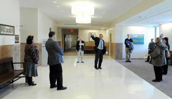 Bill Booth, construction manager, gives a tour to guests to show off the newly renovated Margaret Chase Smith Federal Building and Courthouse following a ribbon cutting ceremony on Thursday.