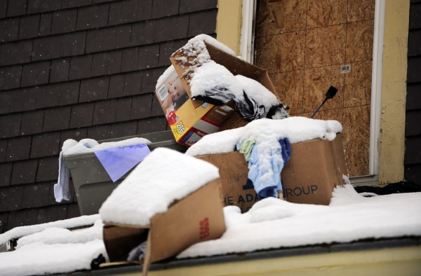 Personal belongings sit in boxes on the roof of the front porch of 40 Dillingham Street in Bangor on Monday.