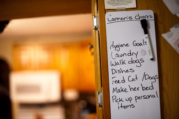 A chore list for Carmen LaPointe hangs in the kitchen of the family's Topsham home. Carmen LaPointe is autistic but doesn't require the same extensive care as her brother Bradley LaPointe, 19.