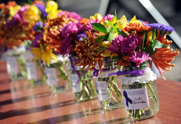 Small bouquets in mason jars lined a table in October, each with the name of people who lost their lives due to domestic violence in Maine in 2013.